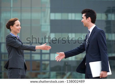 Portrait of a businessman and business woman meeting with a handshake