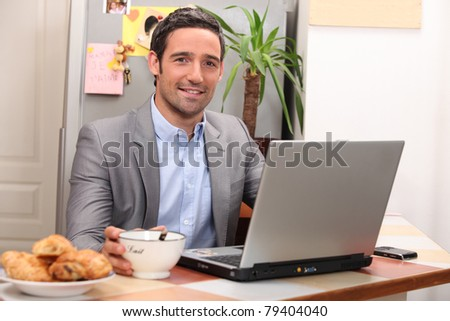 portrait of a businessman at home - stock photo