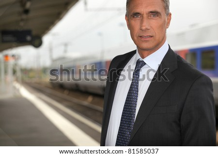 portrait of a businessman at train station - stock photo