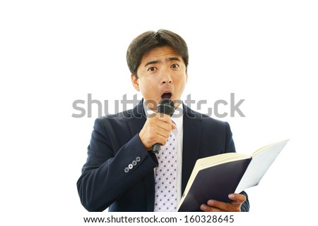 Portrait of a businessman doing a presentation