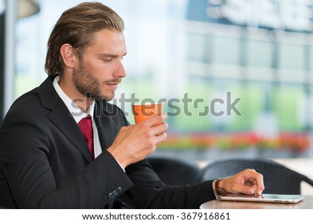 Portrait of a businessman drinking a cup of coffee - stock photo