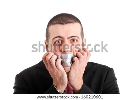 Portrait of a businessman having the mouth closed with tape  - stock photo