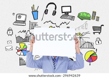 Portrait of a businessman hiding his face behind a blank panel against grey - stock photo