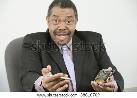 Portrait of a businessman holding a computer board and a pen