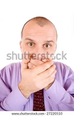 Portrait of a businessman holding hands over mouth - stock photo