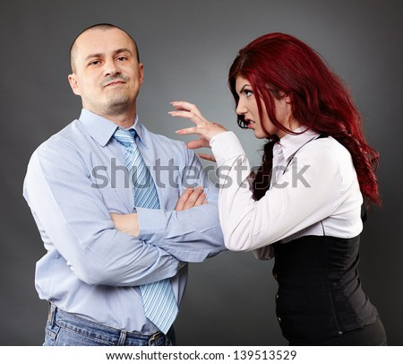 Portrait of a businessman ignoring angry businesswoman - stock photo