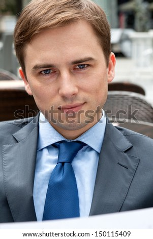 Portrait of a businessman in a restaurant deliberating - stock photo