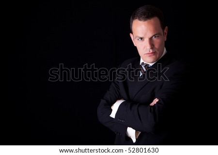 Portrait of a  businessman isolated on black background. Studio shot. - stock photo