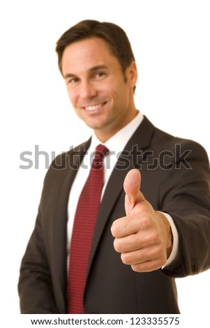 Portrait of a businessman isolated on white wearing a business suit and tie giving a thumbs up  selective focus on thumb - stock photo