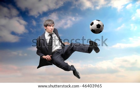Portrait of a businessman kicking a ball - stock photo