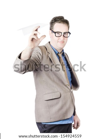 Portrait Of A Businessman Launching Paper Plane On White Background