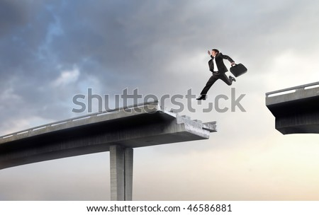 Portrait of a businessman leaping over the empty space between two parts of a broken highway bridge - stock photo