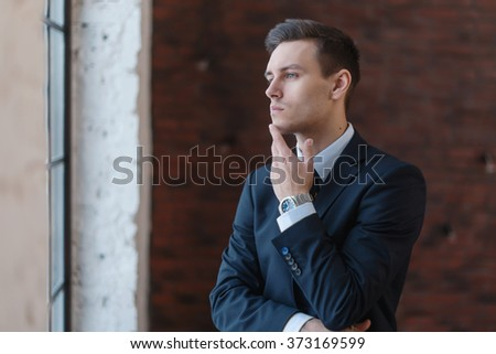 Portrait of a businessman looking at the window. - stock photo