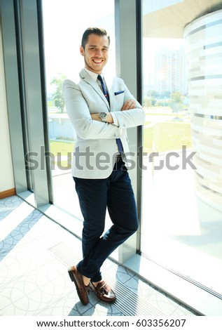 Portrait of a businessman looking at the window.