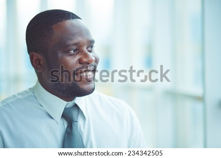 Portrait of a businessman looking away - stock photo
