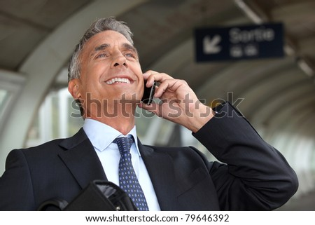 portrait of a businessman on the phone - stock photo