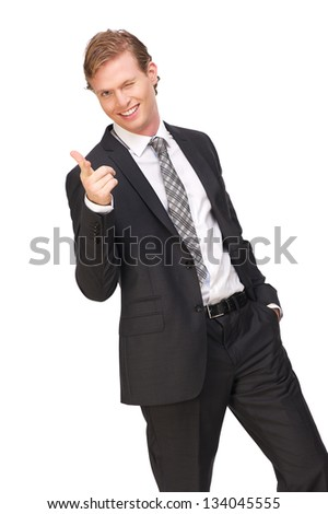 Portrait of a businessman pointing finger - stock photo