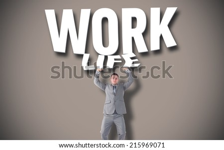 Portrait of a businessman pushing against grey background with vignette - stock photo
