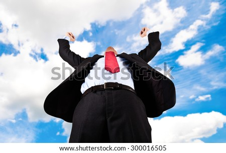 Portrait of a businessman raising arms