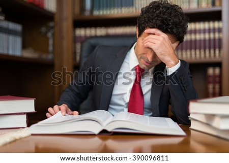 Portrait of a businessman reading a book - stock photo