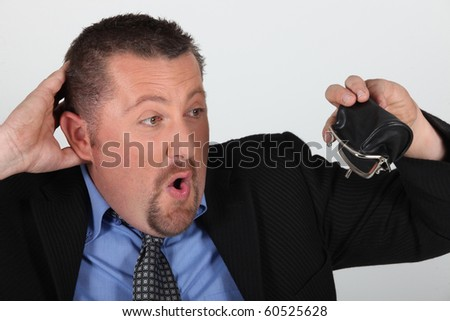 Portrait of a businessman ruined - stock photo