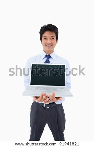 Portrait of a businessman showing a notebook against a white background - stock photo