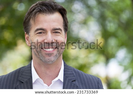 Portrait Of A Businessman Smiling At The Camera - stock photo