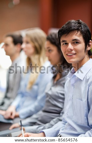 Portrait of a businessman smiling at the camera during a presentation - stock photo