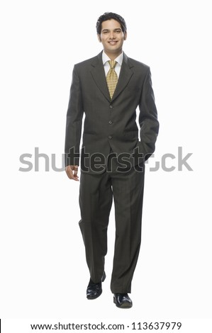 Portrait of a businessman standing against a white background
