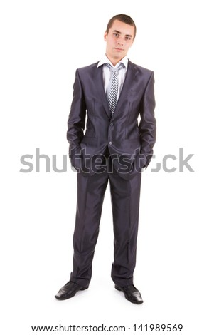 Portrait of a businessman standing against a white background - stock photo