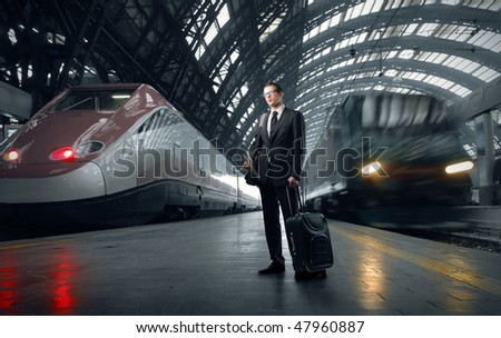 Portrait of a businessman standing on a platform of a train station - stock photo