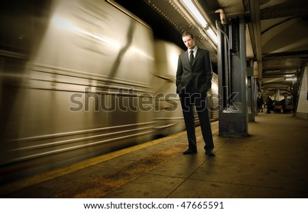 Portrait of a businessman standing on the platform of an underground station - stock photo