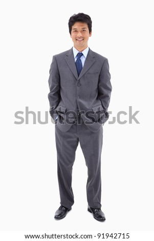 Portrait of a businessman standing up against a white background