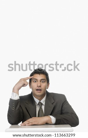 Portrait of a businessman thinking with his eyes wide open - stock photo