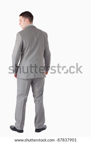 Portrait of a businessman turning his back against a white background - stock photo