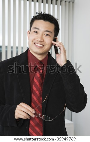 Portrait of a businessman using a mobile phone.