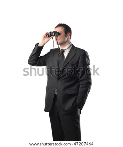 Portrait of a businessman using a pair of binoculars - stock photo