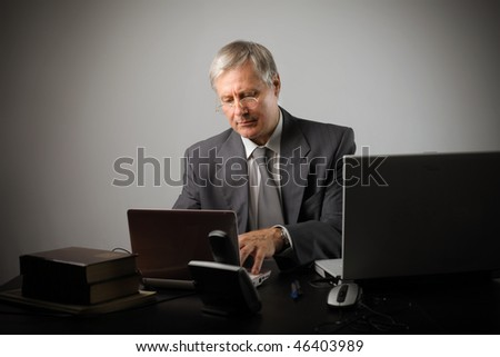 Portrait of a businessman using some IT devices