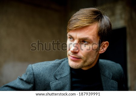 Portrait of a businessman who is focused and looking away, closeup  - stock photo