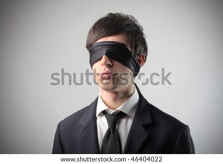 Portrait of a businessman with a bandage on his eyes - stock photo