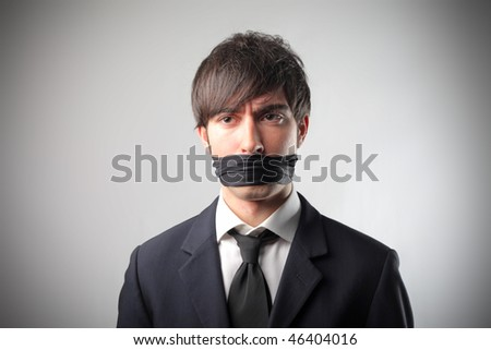 Portrait of a businessman with a bandage on his mouth - stock photo