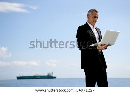 Portrait of a businessman with a laptop computer - stock photo