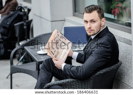 Portrait of a businessman with a newspaper