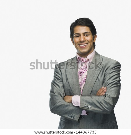 Portrait of a businessman with arms crossed - stock photo