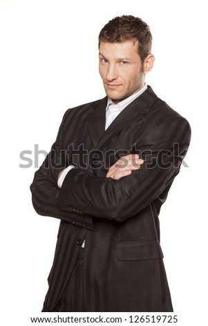 Portrait of a businessman with arms crossed on white background - stock photo