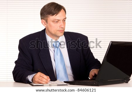 portrait of a businessman with computer