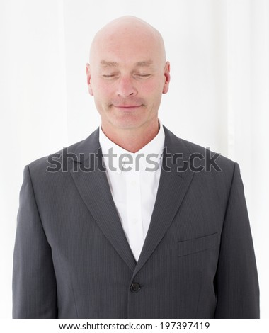 portrait of a businessman with his eyes closed - stock photo