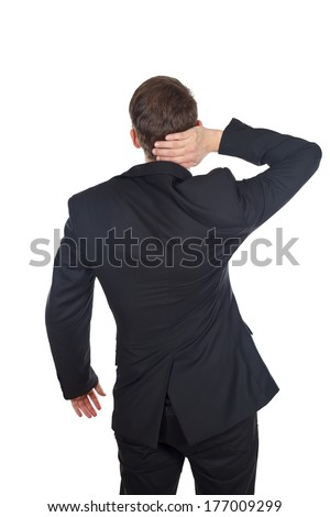 Portrait of a businessman with neck pain on isolated background