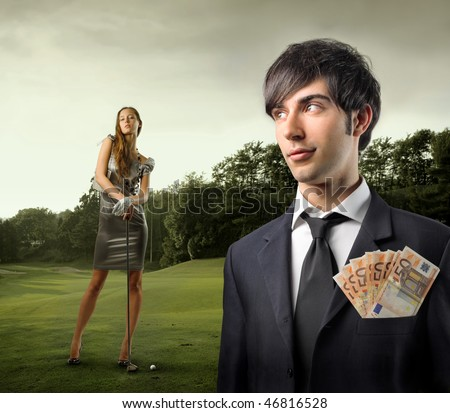 Portrait of a businessman with some banknotes in his breast pocket and an elegant woman holding a golf club - stock photo