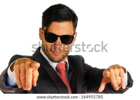 Portrait of a businessman with sunglasses pointing. Over white background